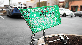 Abandoned Green Cart In A Parking Lot As A Metaphor For Revenues Lost Online Stores