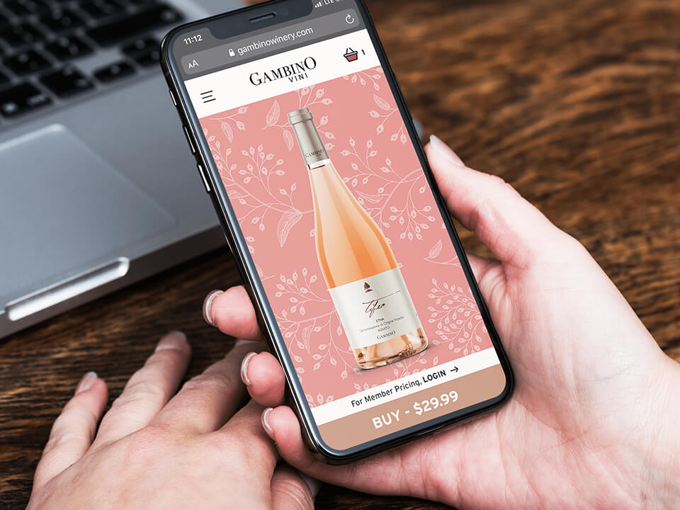 Woman Holding SmartPhone with Winery Website Design Showing