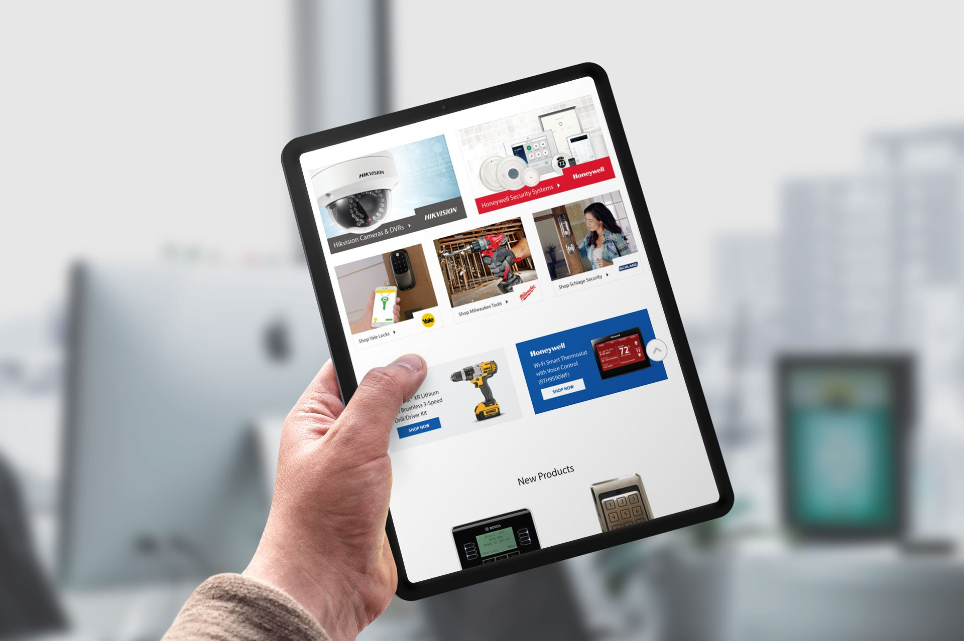 Hand Holding A Tablet With Online Security Superstore Product Page On Screen