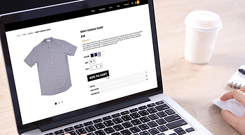 A Laptop With BigCommerce Website Item Page  With A Pricing Option On Screen