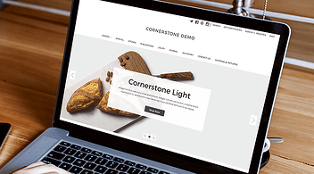 Laptop With Cornerstone Demo On Screen Made Using BigCommerce Stencil Theme