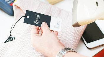 Woman Scanning A Barcode To Accept A Return Of An Online Purchase