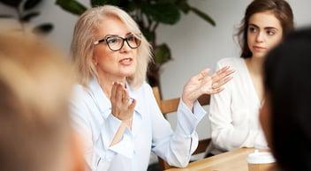 Women Discussing Strategies For BigCommerce SEO Optimization