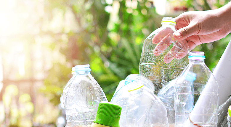 Person Collecting Biodegradable Plastic Bottles And Packaging