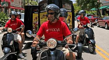 People Riding Scooters Around The City During An Experiential Marketing Event