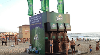 Sprite Quick Shower Booth Set Up On A Beach For An Experiential Marketing Event