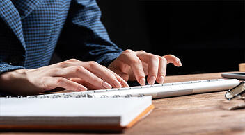 Brand Marketing Consultant Typing On Keyboard