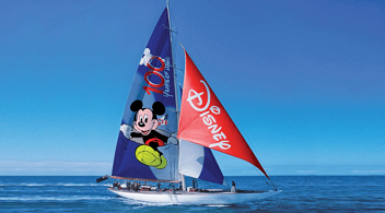 A Disney Branded Sailboat Advertisement On Agency Website Featuring Mickey Mouse