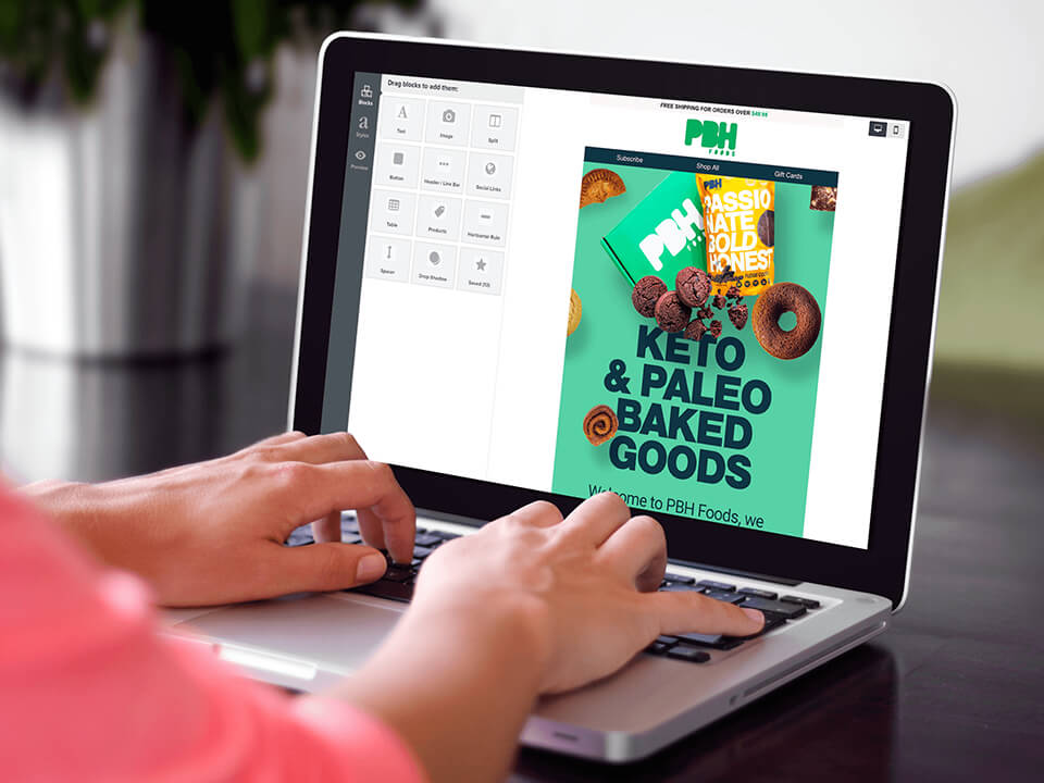 Woman Designing an Email Marketing Campaign for CPG Food Brand on Laptop