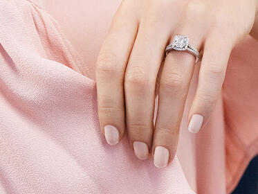 Ring on Hand Holding Pink Fabric in Marketing Agency Photo