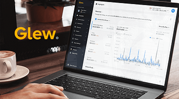 Logo Of The Business Intelligence Platform Glew With Customer And Product Analytics Page On Laptop Screen In The Background