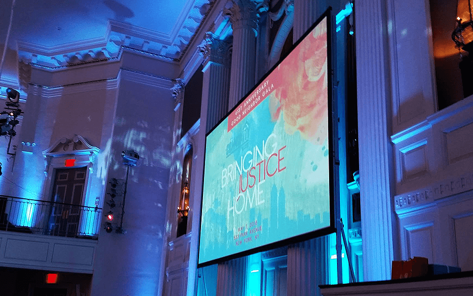 Screen Display About Justice At Gala Event