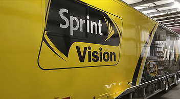 Huge Experiential Truck With Sprint Vision Logo On It At A Brand Marketing Event