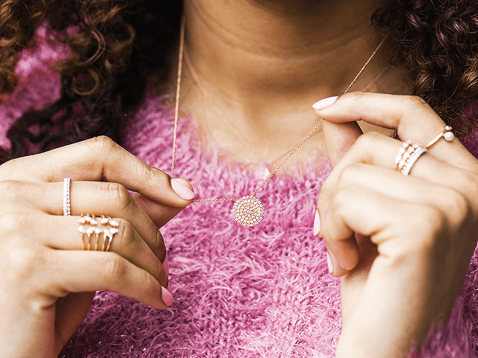 Jewelry Marketing Company Image Of Woman Wearing A Necklace And Gold Rings