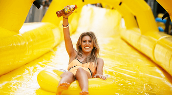 Female On A Waterslide With Lipton Tea In Her Hand At An Experiential Marketing Event