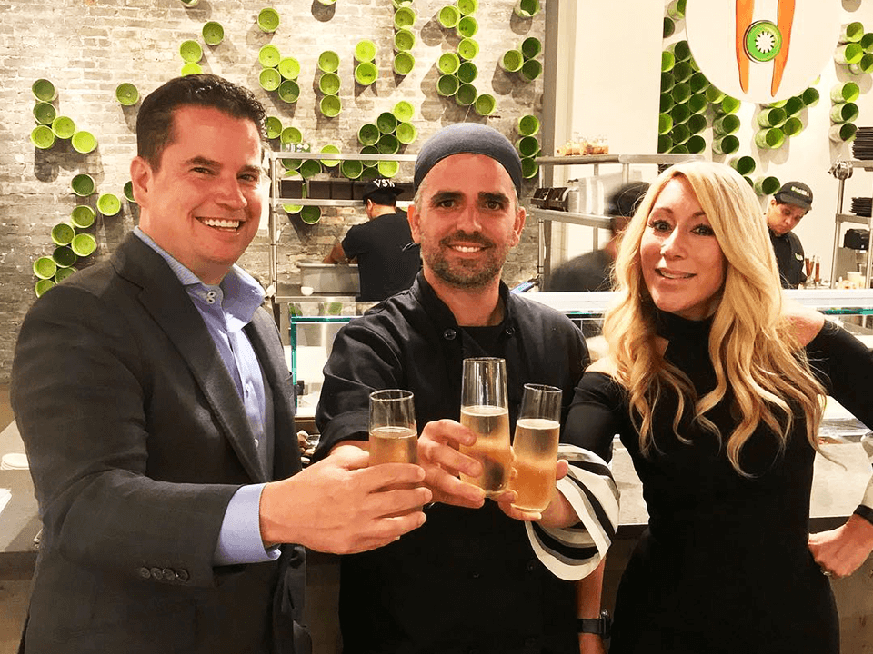 Marketing Event With Three Investors Smiling