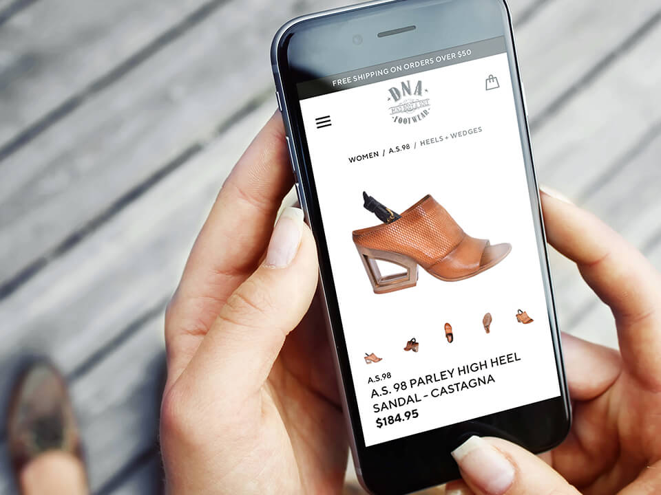 Footwear Marketing Agency Mobile Development For Shoe Retailer Displayed On A Cellphone
