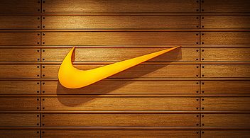 Orange Nike Logo On Sustainable Wooden Panel At The Company's Business Office