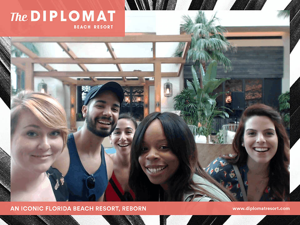 Group Of Friends In Branded Photo Of A Hotel Social Media Marketing Campaign