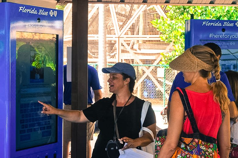 2 Women Using An Outdoor Photo Booth