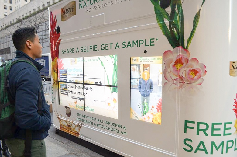 Event Marketing Photo Booth With Man Taking A Selfie In Exchange For Sample Product