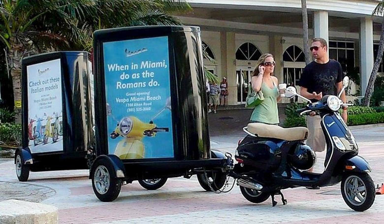 Branded Signs on Scooter Trailers