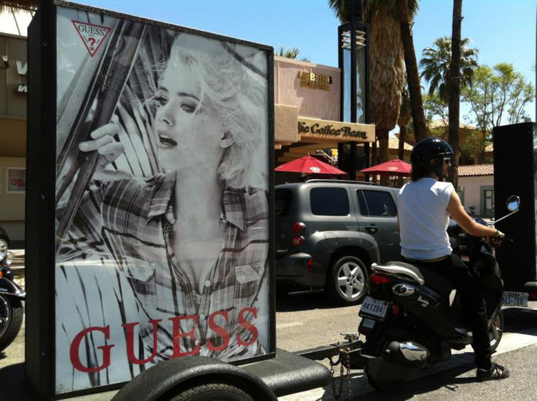 Experiential Marketing Scooter Towing a Billboard With A Branded Photo