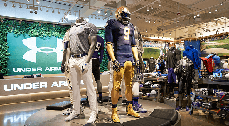 Product Packaging Design Influences Perceived Value - Under Armor Store Display