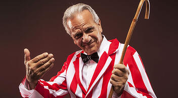 Old Man With A Cane Wearing Striped Blazer For An Editorial Photoshoot For a Blog About Inbound Marketing