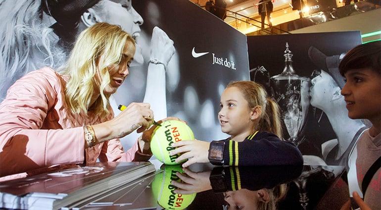 Influenbcer Giving An Autograph To A Girl At An Event