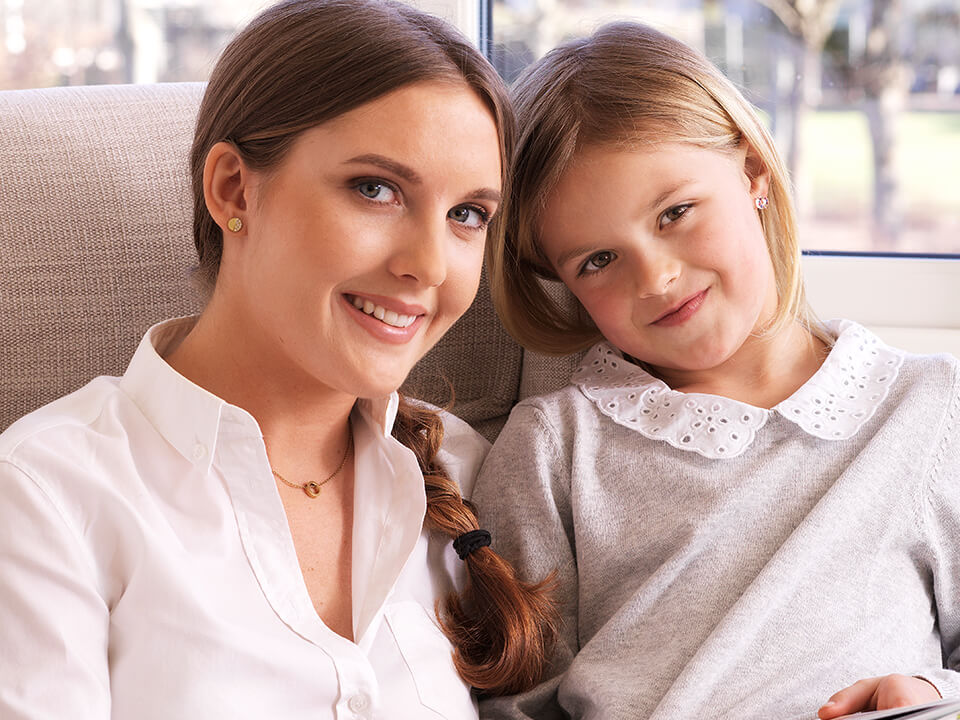 Mother And Daughter Ear Piercing With Medical Jewelry