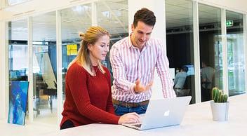Marketing Agency Employee Explaining Seven Main Marketing Tips To An Intern