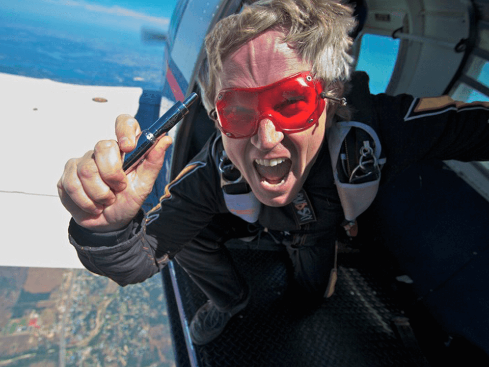 Vape Marketing Advertisement Showing Skydiver Holding Vaping Device About To Jump From a Plane