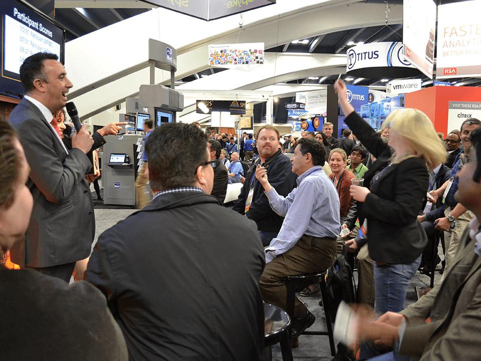 Live Event Held by a Cybersecurity Marketing Agency Showing Crowd and a Man Holding a Microphone
