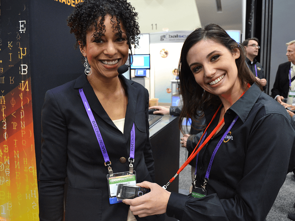 Two Women Posing During A Cybersecurity Marketing Agency Lecturer
