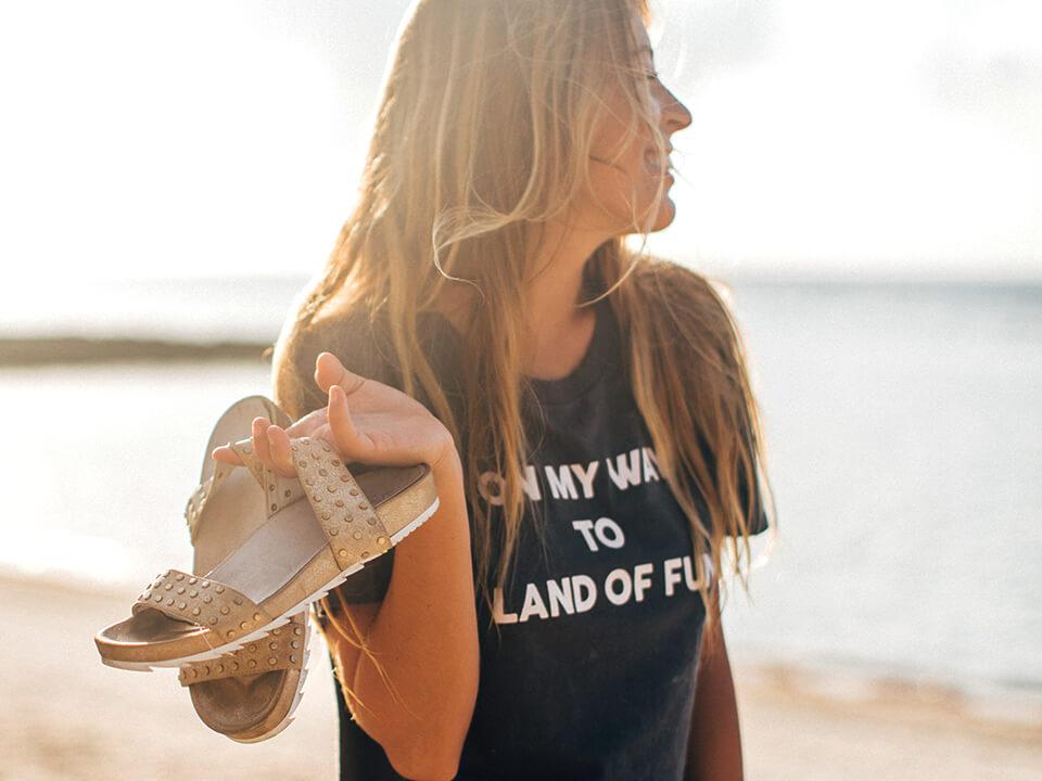Footwear Brand Marketing Agency Photo Of Sandal In Girl Hand