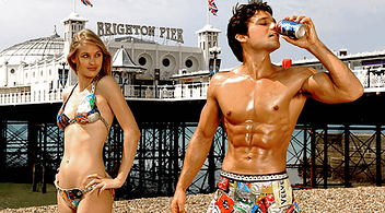 Brighton Pier And Two Young Content Creators At The Beach Posing For Blog Pictures