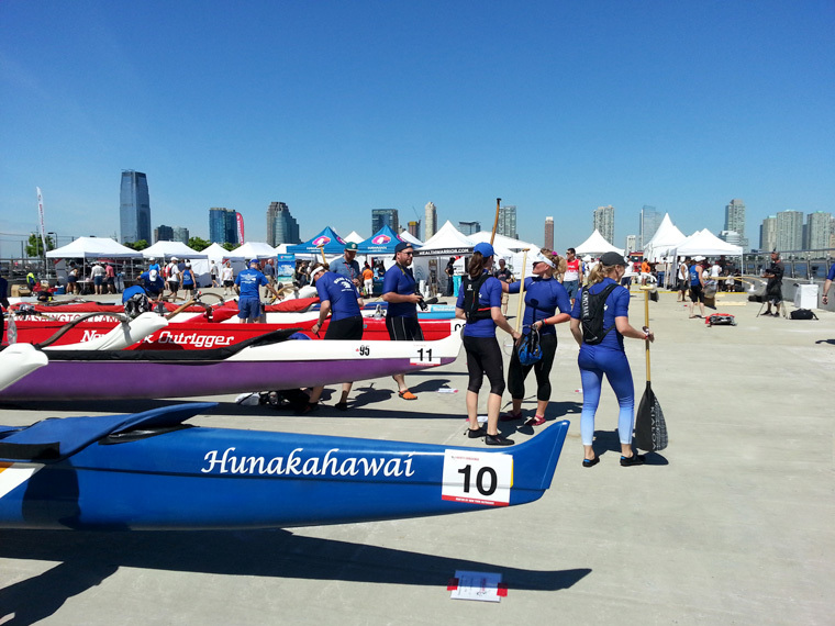 Branded Boats Lined Up Next To Rowing Teams