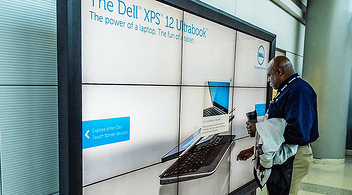 A Man Looking At An Interactive Advertisement Of An Ultrabook At An Experiential Brand Marketing Event