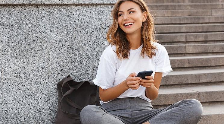 Beautiful Woman On Mobile Device