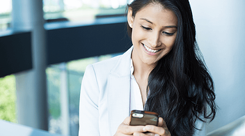 A Young Woman Connecting With Business Owners On Social Network LinkedIn On Her Smartphone