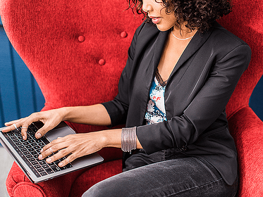 Woman Typing On Laptop Featured On BigCommerce Marketing Case Study