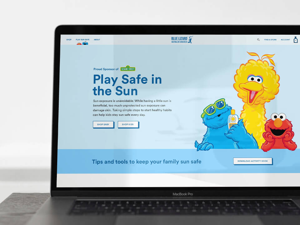 Web Design Agency Landing Page with 3 Graphics of Sesame Street Characters on Laptop