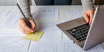 Web Designer Working Working On Website Layout And Style To Optimize Conversion Rate