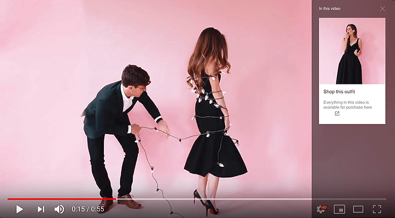 YouTube Shoppable Video Example of a Guy Wrapping A Lady In a Black Dress With Lights