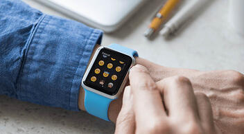 Man Choosing Emojis For His Social Media Post On A Smartwatch Screen
