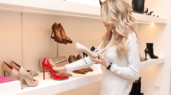 A Woman Picking Out New Shoes For Footwear Marketing Advertisement Photoshoot