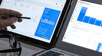 Two Laptop Screens With SEO Statistics And Strategies For Optimization