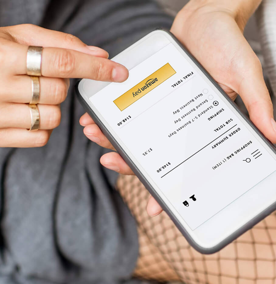 Hands Holding A Mobile Phone Showing A Shipping Order Via Amazon Pay On The Screen