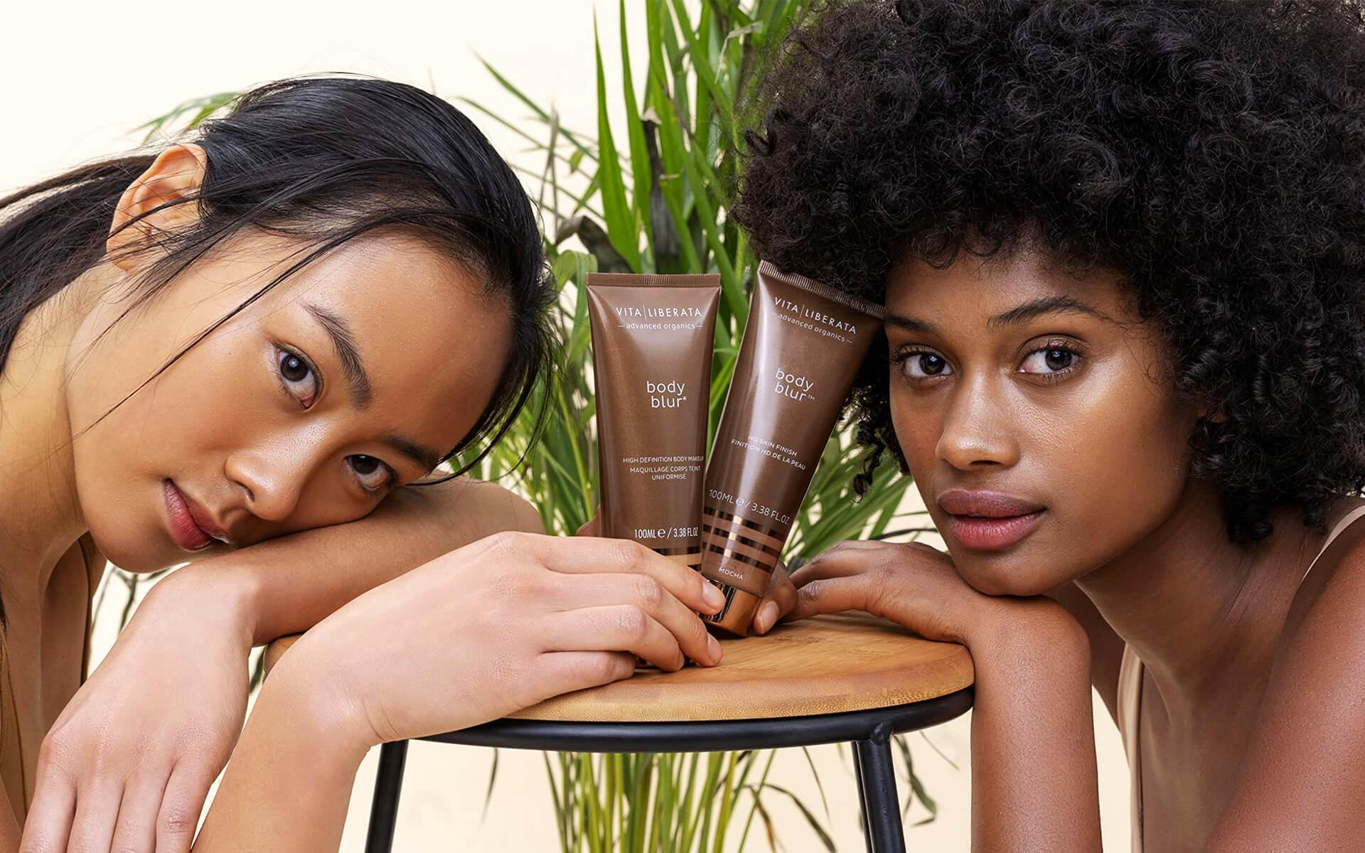 Beauty Marketing Agency Photo Feature of Two Women Holding Vita Liberata Products